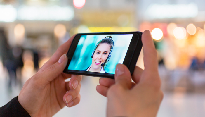 Someone holding a phone and on a video call