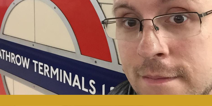 Close up photo of Stephen in front of the sign for Heathrow Terminals Underground Station