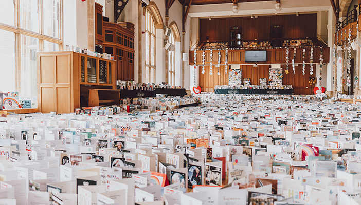 Thousands of birthday cards on display in the Great Hall at Bedford School
