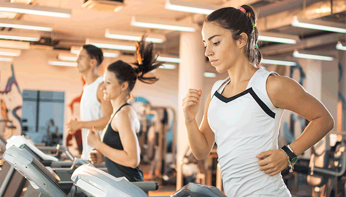 Photo of people at the gym on treadmills