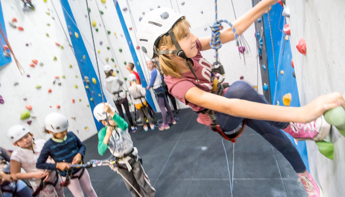 Young girl rock climbing