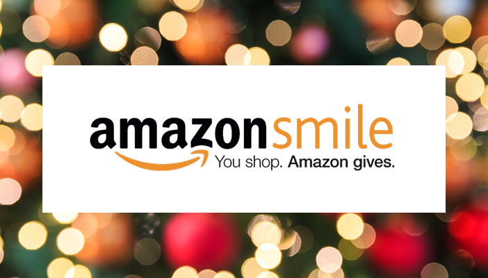 AmazonSmile logo with Christmas backdrop
