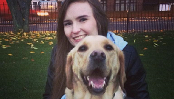 Amy and her guide dog Bingo who is a golden Labrador Retriever cross