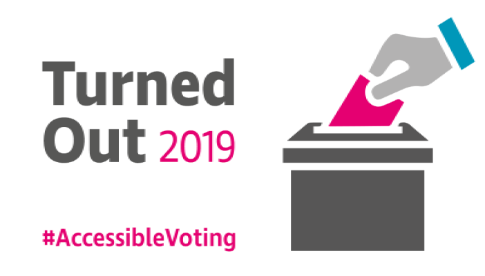 Image of a hand putting a ballot paper into a ballot box. Turned Out 2019 #AccessibleVoting.