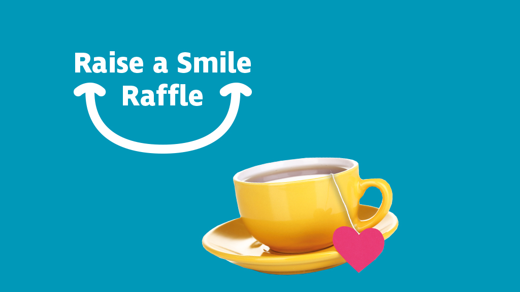 """""""Raise a Smile Raffle"""" written on a blue background, with a cup of tea next to it"""
