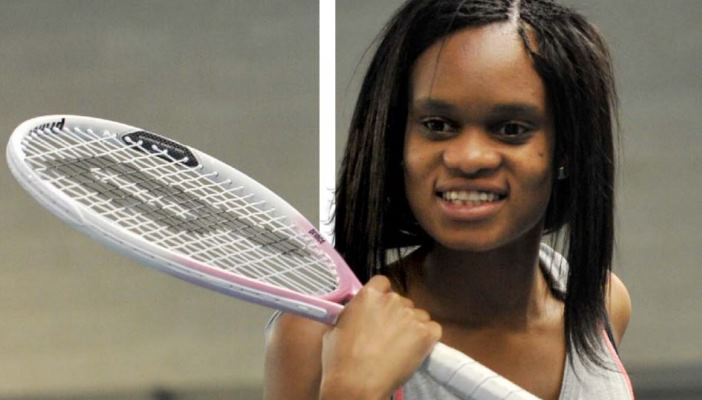 Girl participating in tennis