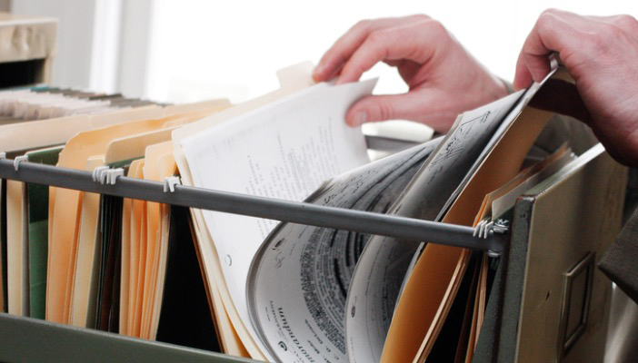 Picture of person searching through files