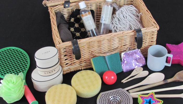 Photo of a basket with miscellaneous items in front