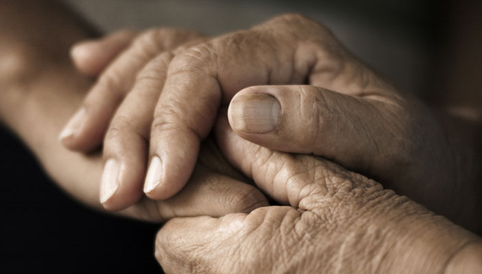 Close up of two hands being held