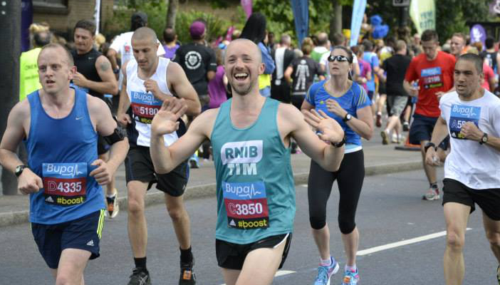 RNIB runner celebrates during the Great North Run