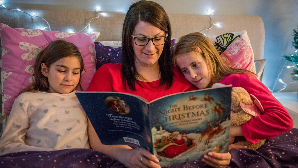 Carolyn reading The Night Before Christmas to her children