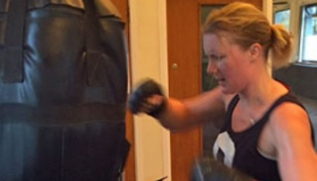 image shows claire lawrence training with a punch bag