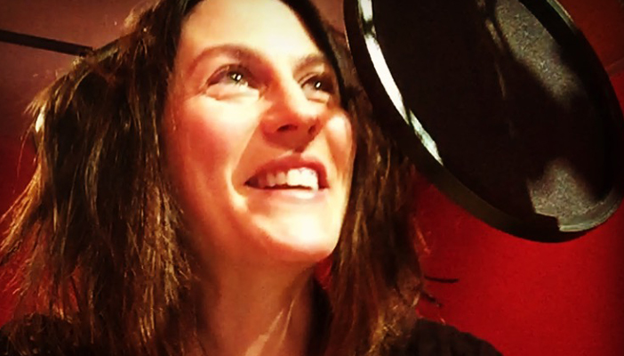 Claire Morgan in front of a recording microphone
