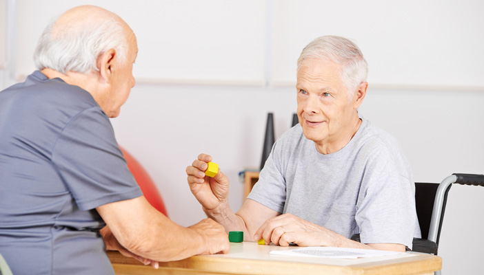 Two men playing games in a care home