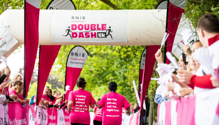 A Double Dash charity fun run pair are cheered to the finish line