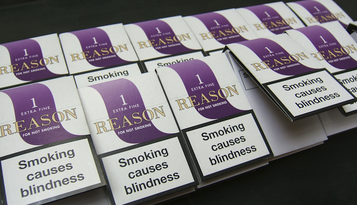 Mocked-up cigarette packets with eye health warnings
