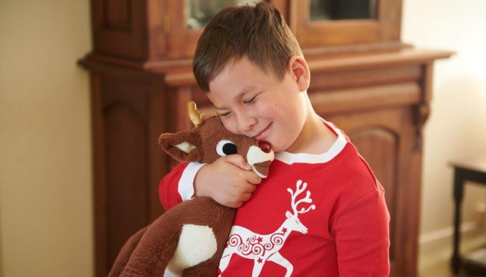 Ed hugging his Rudolph plush toy