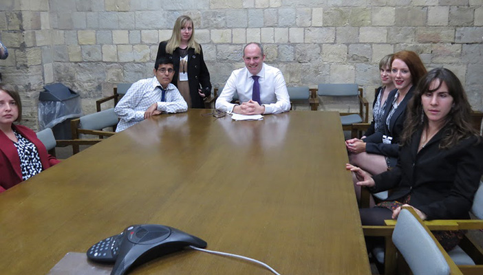 Envision group at Parliament meeting.