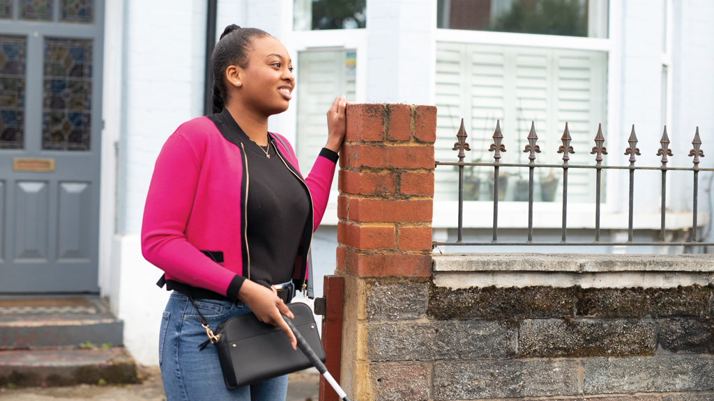 Holly leaving her house with a cane in hand