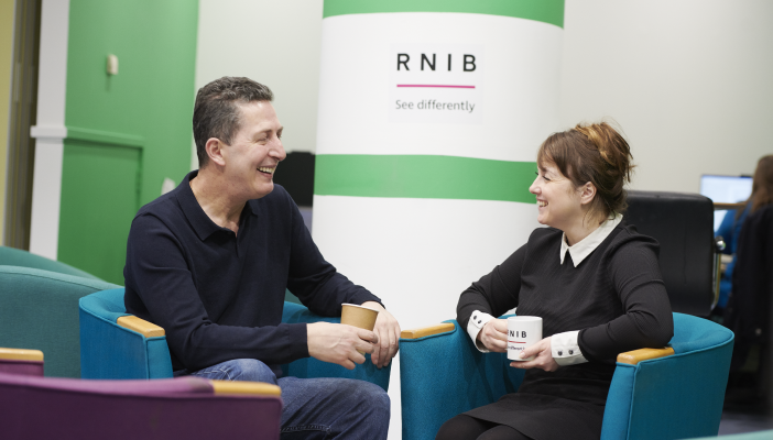 Fitim and RNIB Employment Adviser, Emma, sat down talking.