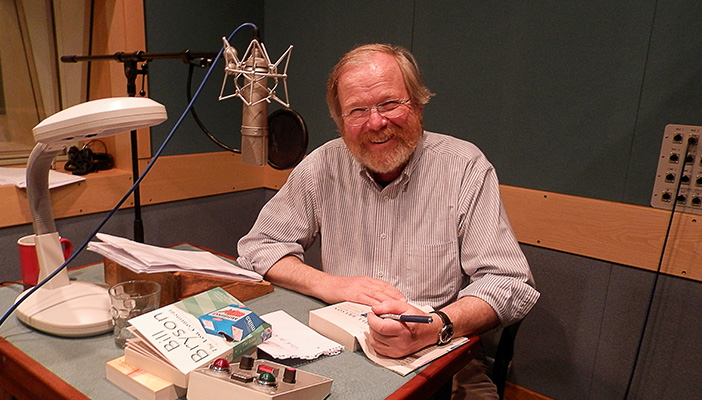 Bill Bryson signs a copy of his book