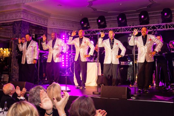 The Foundations on stage singing at our Gala