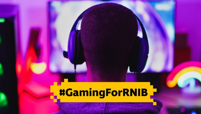 The back of someone's head who is wearing headphones and text reading Gaming for RNIB