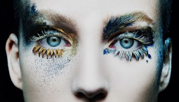 a close up of a woman's eyes in a wide range of colours, it's very psychedelic