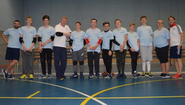 Photo of Goalball players and the UK CEO on a court