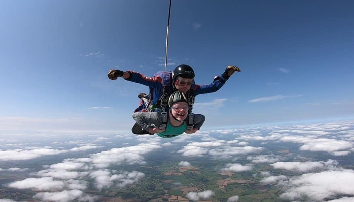 Jack in mid air skydiving as part of the Big Jump