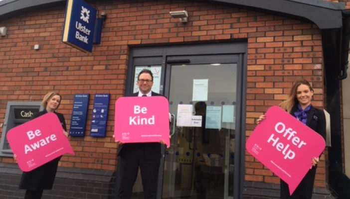 Ulster Bank staff holding signs of support outside one of their locations