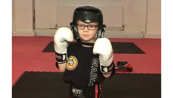 Photo of Junior in his martial arts uniform