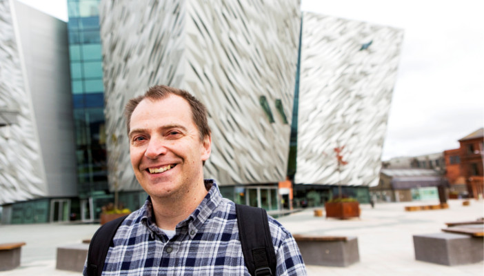 A smiling man outside the Titanic Belfast museum