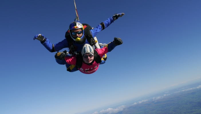 Kieron smiling as he free falls from 10,000 ft