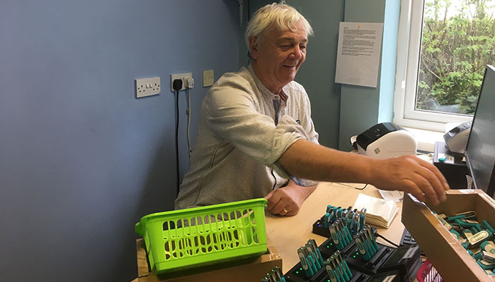 Laurence in the office processing USB sticks