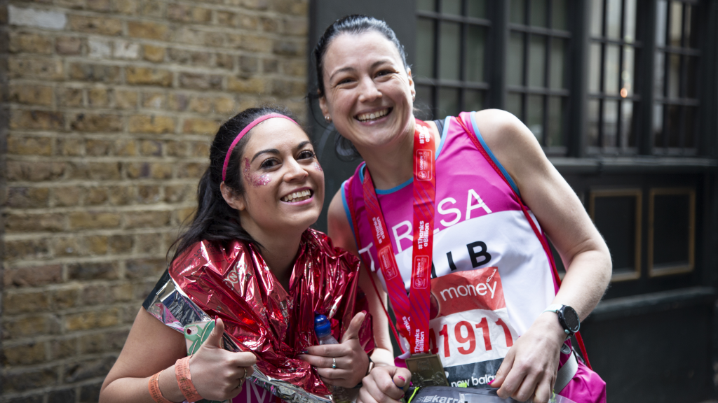 London Marathon runners celebrate with their medals