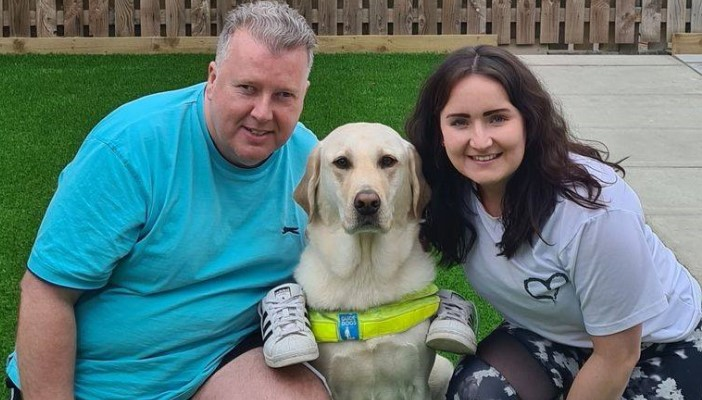 Allan, his daughter Laura and guide dog Quigley