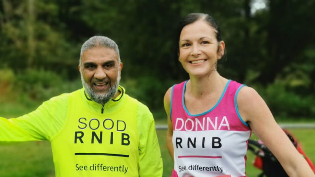 Mas and Donna wearing RNIB T-shirts, smiling after finishing a challenge