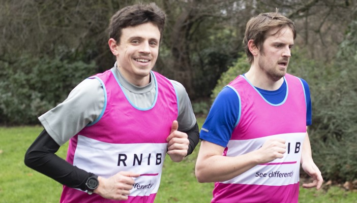 Matthew and Huw Rowcliffe running wearing Team RNIB vests