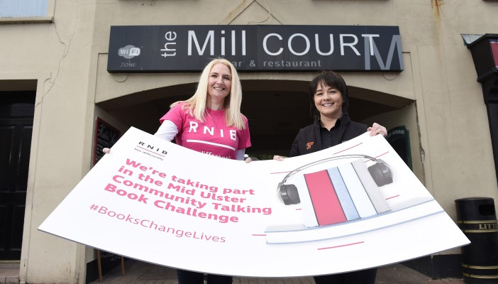 Alerian Taggert from The Mill Court holds sign with Jackie Cotton from RNIB