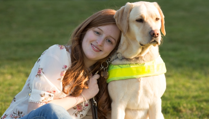 Photo of Emily and her guide dog Unity