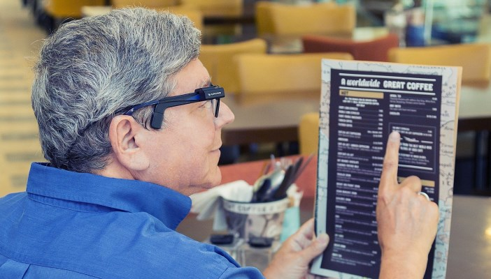 Man using using OrCam to read a menu