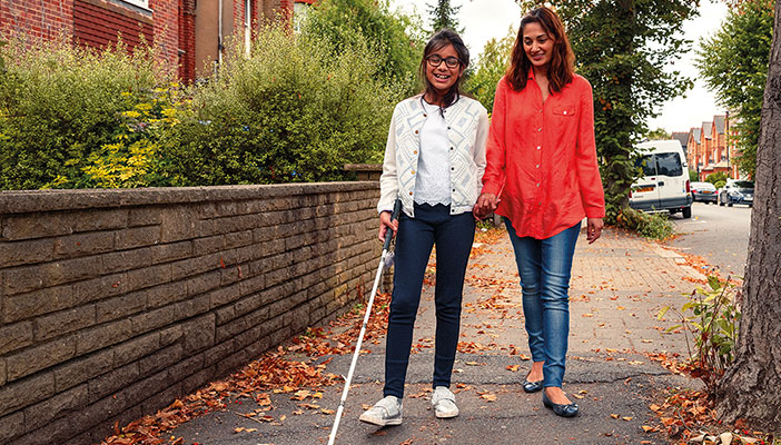 Cover image for the Our Futures Matter report feature a girl with vision impairment using a cane and an older woman walking along a pavement