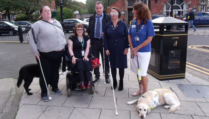 Campaigners with MP on blindfold walk