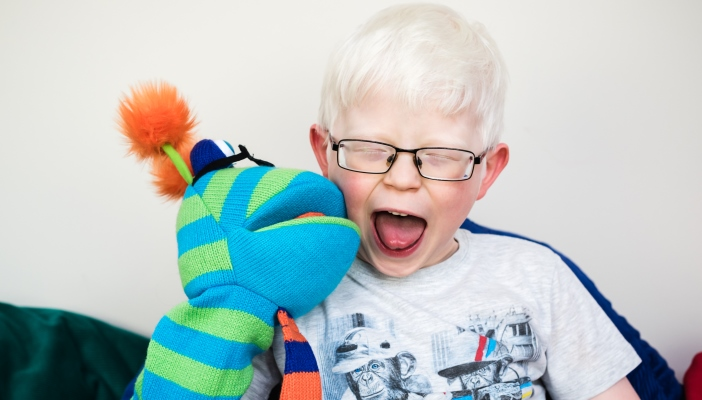 Boy playing with puppet
