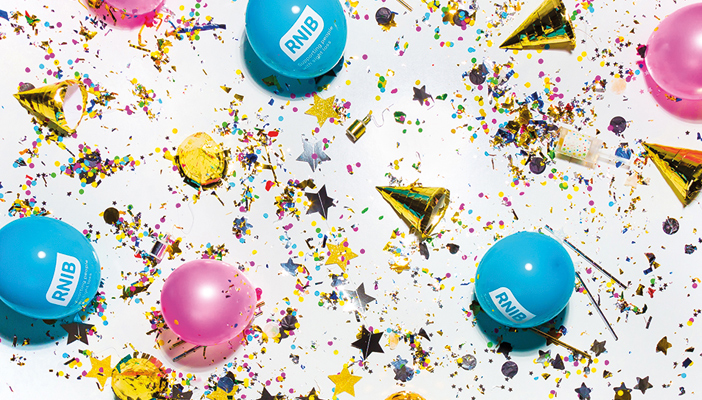 Image shows confetti and RNIB balloons