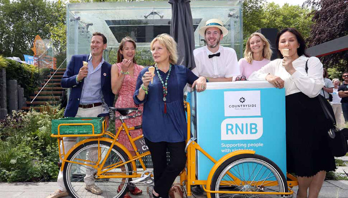 Brendan Cole, Anna Maxwell Martin, Jennifer Saunders, (RNIB ice cream representative), Zoe Hobbs (wife of Brendan Cole), and Arlene Philips visiting the RNIB Mind's Eye garden