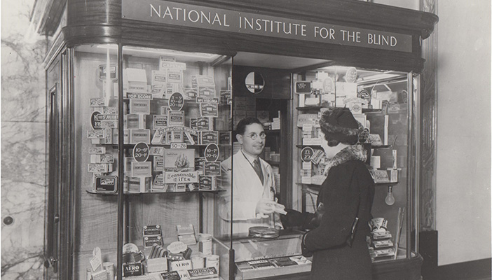 Historical black and white photo of an RNIB employment kiosk