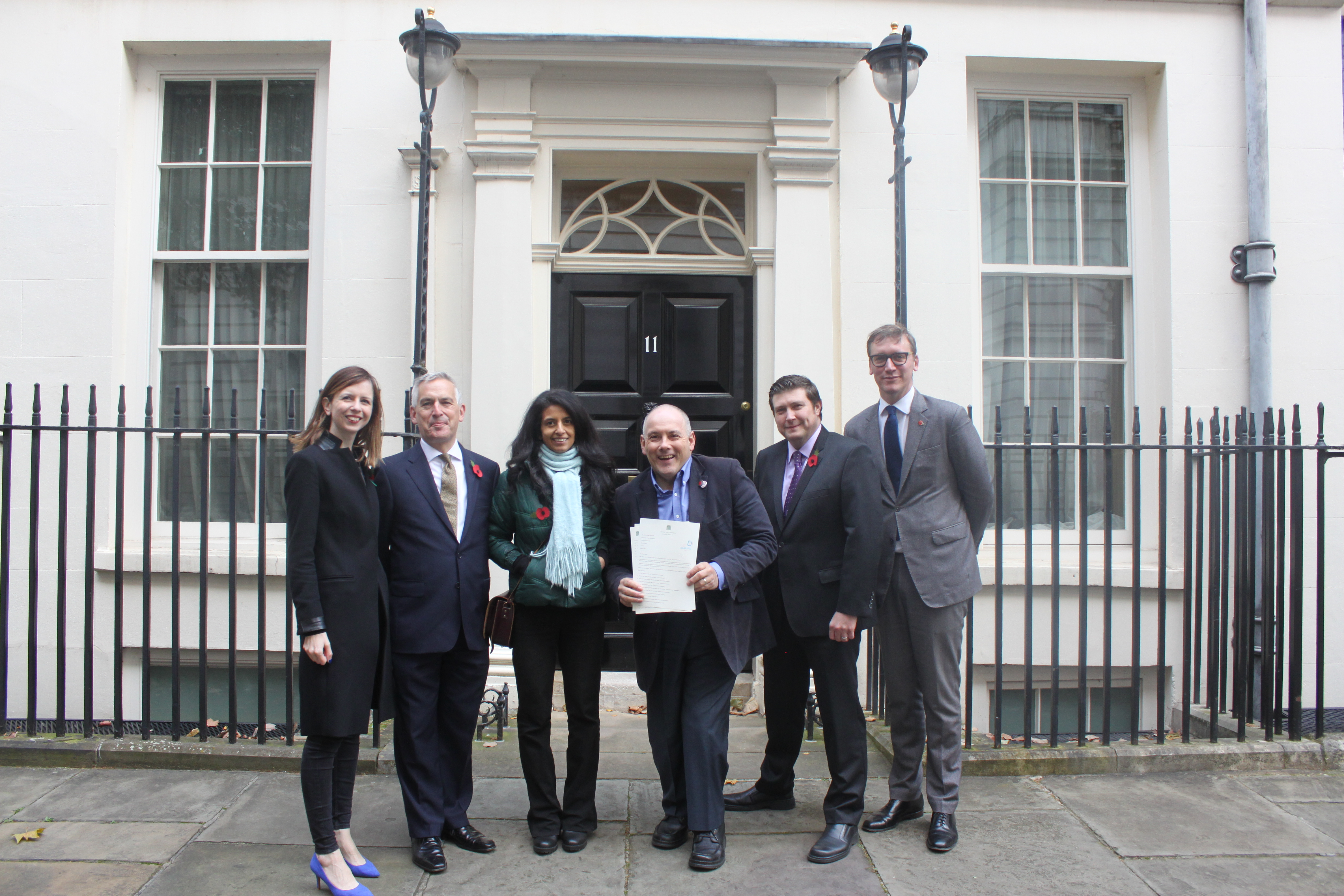 From left to right, in front of 11 Downing Street: Eleanor Thompson, RNIB Head of Policy and Public Affairs, Jonathan Douglas, CEO of the National Literacy Trust, Konnie Huq, children's author and ex-Blue Peter presenter, Robert Halfon MP.