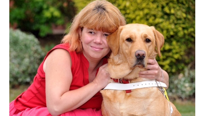 Photo of Sarah with her Guide Dog